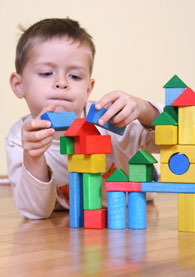 Boy with building blocks